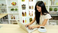 Young Asian Ethnic Girl Kitchen Coffee Laptop Stock Footage