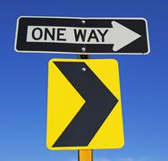 One Way and arrow street signs Stock Photos