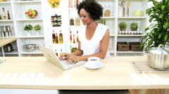 Ethnic Female Kitchen Laptop News Success Stock Footage