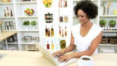 African American Female Wireless Laptop Kitchen - stock footage