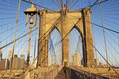 Person jogging on Brooklyn Bridge, New York City - stock photo