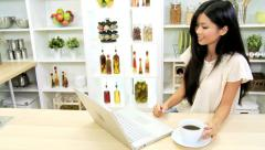 Pretty Ethnic Girl Laptop Social Media Kitchen Counter Stock Footage