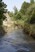 ford through river at lacock. wiltshire. england - stock photo