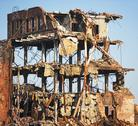 Stock Photo of Demolished building under blue sky