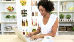 Ethnic Female Kitchen Laptop News Success - stock footage