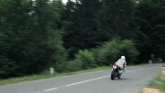 Stock Video Footage of Sport Motorcycle Cornering Uphill