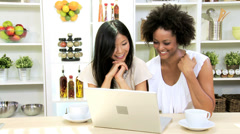 Female Friends Social Networking Kitchen Laptop - stock footage