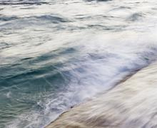 Blurred motion shot of ocean waves - stock photo