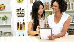 Young Multi Ethnic Girlfriends Listening Music via Tablet Stock Footage
