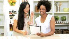 Female Friends Music Downloads Tablet Kitchen - stock footage