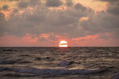 Sun touches the sea. - stock photo