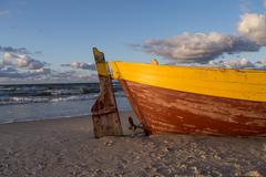 Old boat in the sand. - stock photo