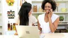 Female Friends Talking Smart Phone Kitchen Stock Footage