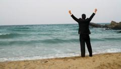 Businessman jumping in water beach awaited vacation concept Stock Footage