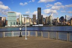 Pier and cityscape - stock photo
