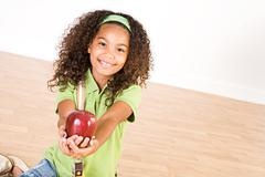 student: student girl holding an apple - stock photo