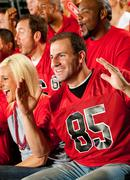 Fans: male fan's team scores touchdown Stock Photos