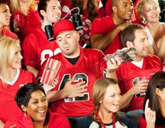 Fans: man gets sick from too much stadium food Stock Photos
