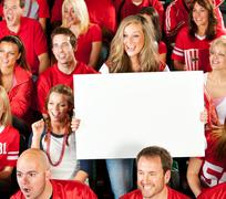 fans: female fan holds up blank sign - stock photo