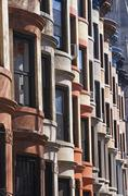Windows on brownstone buildings - stock photo