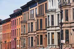 Row of brownstone townhouses - stock photo
