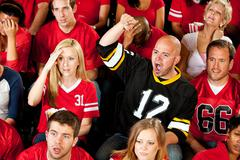 fans: one man cheers for the other team - stock photo