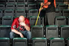 fans: upset football fan after game - stock photo