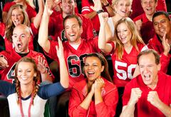 Fans: team scores touchdown and fans cheer Stock Photos
