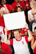 fans: team fan holds up blank sign - stock photo