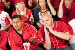 fans: fans boo a play on the field - stock photo