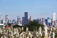 USA, New York City, Cemetery with downtown skyline - stock photo
