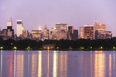 USA, New York State, New York City, Skyline with Bloomberg Building at dusk, - stock photo