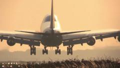 Big Jumbojet landing at sunrise Stock Footage