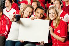 Stock Photo of fans: friends hold up blank sign