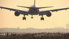777 Airplane landing at sunrise Stock Footage
