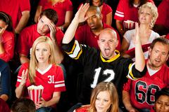 fans: one fan excited about touchdown - stock photo
