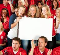 Stock Photo of fans: excited women cheering with blank sign