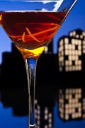 Metropolis manhattan cocktail in city skyline setting Stock Illustration