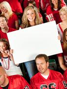 fans: cute woman holds up blank sign - stock photo