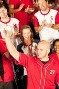Fans: man shows off caught baseball Stock Photos