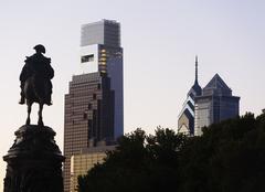 USA, Pennsylvania, Philadelphia, Silhouette of statue, Skyscrapers in background - stock photo