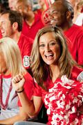 fans: woman fan cheers for team - stock photo