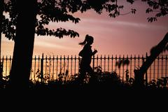 USA, New York City, Woman jogging in park - stock photo