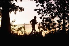 USA, New York City, Woman jogging in park Stock Photos