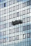 USA, New York City, Manhattan, window cleaning platform on building - stock photo