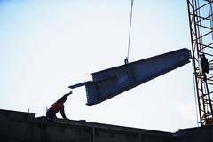 USA, New York City, girder being lifted at construction site - stock photo