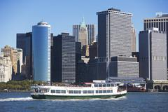 USA, New York City, Manhattan skyline with ferry - stock photo