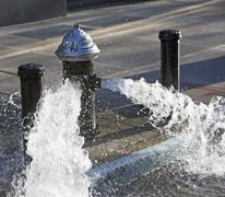 USA, New York City, hydrant pouring out water Stock Photos