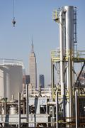 USA, New York City, Refinery installations with Empire State Building in Stock Photos