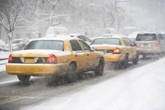 Stock Photo of USA, New York City, yellow cabs on snowy street